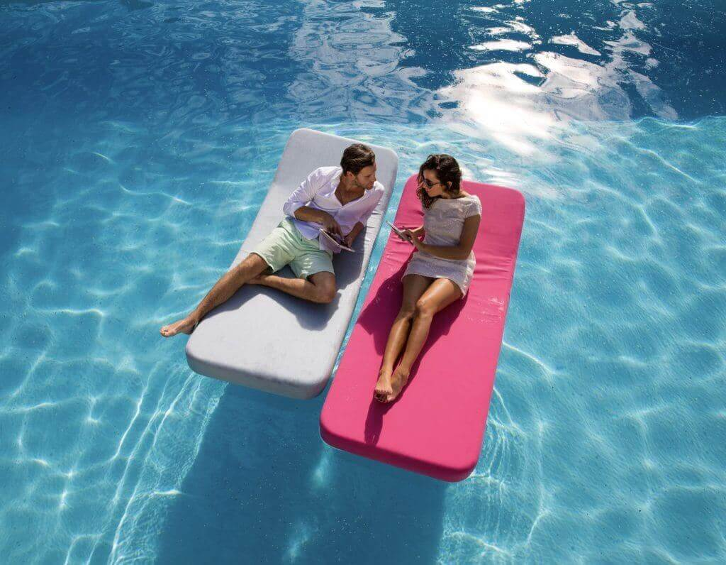 2 upholstered floating loungers in pool